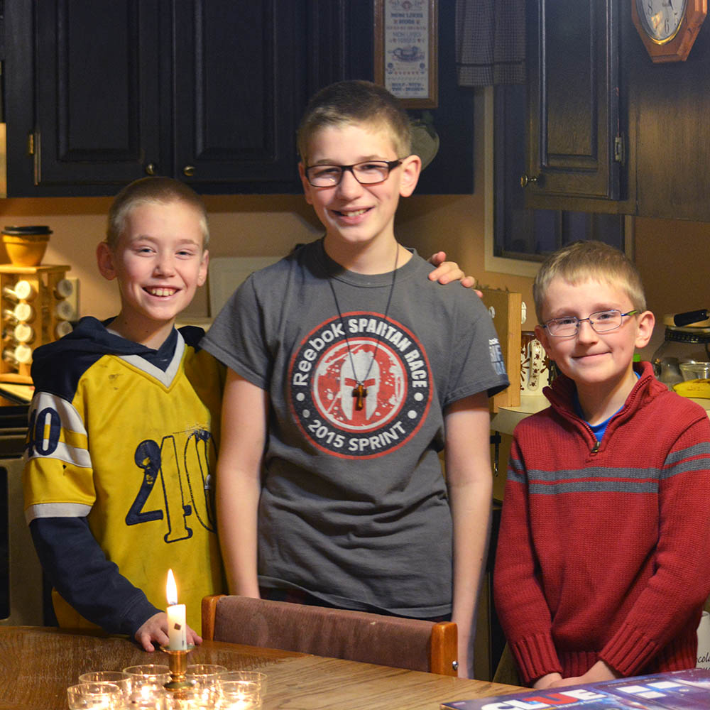 """Speaking of geeks, we are training the next generation well--we celebrated the last night of Hanukkah by playing our new board game, """"Doctor Who Clue"""". Taking pictures of my boys minus one is hard. But I just gotta keep reminding myself that Levi is having sleepovers in heaven while he waits for us to get there."""