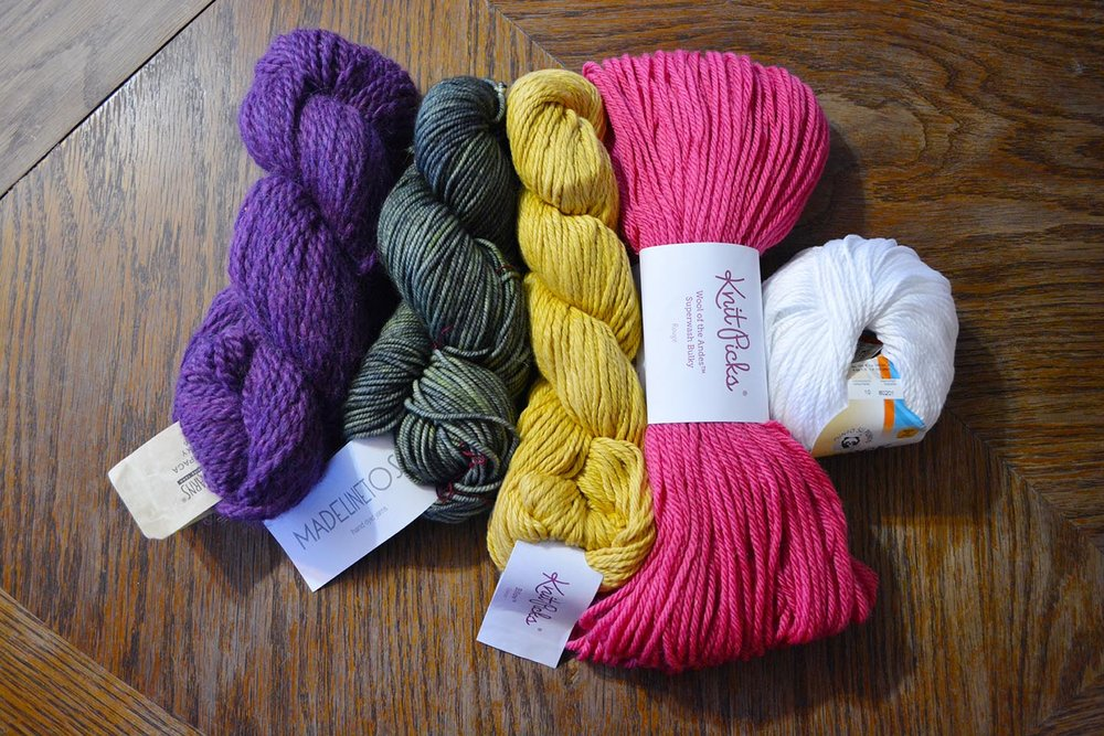 "These are all 100 g/3.5 oz skeins of ""Bulky"" weight yarn (#5.) The yardages on each skein, from left to right, are: 108 yards, 165 yards, 120 yards, 137 yards, 132 yards."