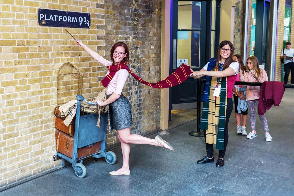 Potter fans pose at King's Cross Station's Platform 9 3/4. Photo copyright madrabothair/123RF Stock Photos