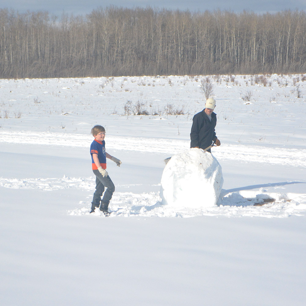 This base snowball became a ginormous seven-foot-tall snowman. Go, team Jabin!