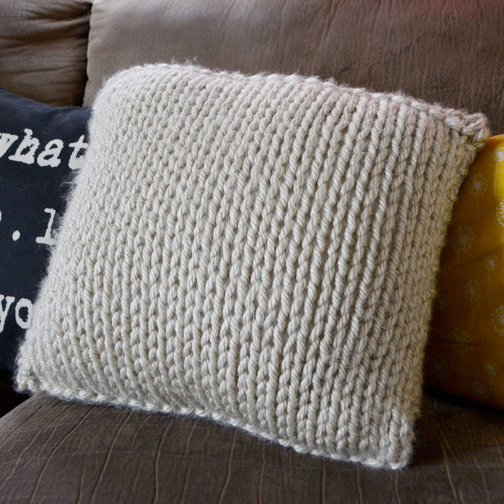 Fast-finish statement Pinnable Pillow Cover knitting pattern. Perfect for beginners!