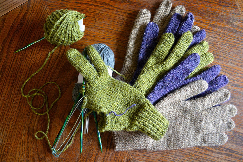 The beige gloves used Knit Picks Wool of the Andes Superwash.
