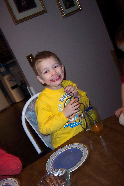 "Obligatory, cheesy ""I'm-posing-for-the-camera"" Birthday Boy grin."