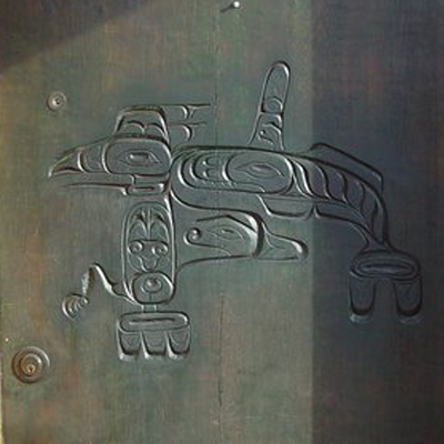 SALVAGED WOOD DOOR CARVED BY A NATIVE NORTHWEST INDIAN ARTIST