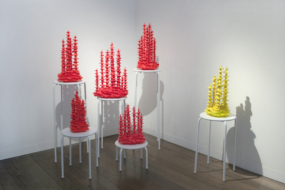 TRACY SARROFF     Glow-in-the-dark Stalagmites , installation 2013 Wood, Expanding Foam Paint, Phosphorescent paint, Epoxy resin