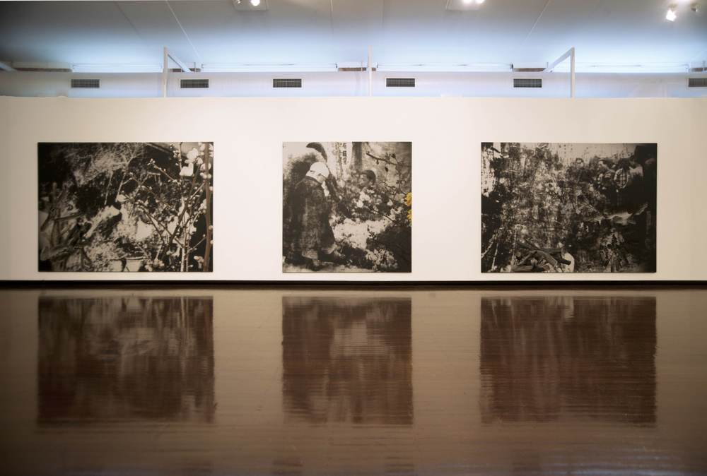 JOHN YOUNG     Safety Zone , installation view: F lower Market (Nanjing 1936) #2  (left) and  Flower Market (Nanjing 1936) #3  (centre),  Flower Market (Nanjing 1936) #1  (right) 2010