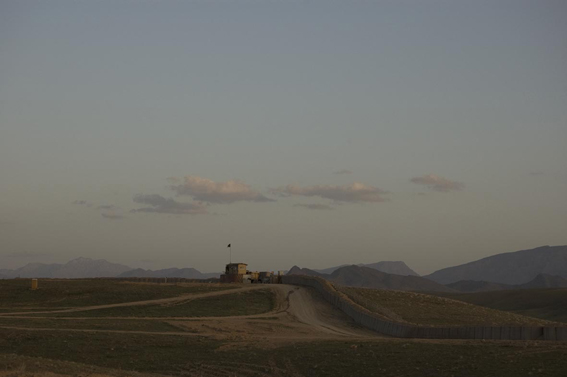 LYNDELL BROWN CHARLES GREEN     Dusk, Hillside Perimeter with Afghan National Army Observation Post in Distance, Tarin Kowt Base, Uruzgan Province, Afghanistan  2007-08 Digital colour photographs, inkjet prints on rag paper, unframed edition of 5 11  1.5 x 15  1.5 cm