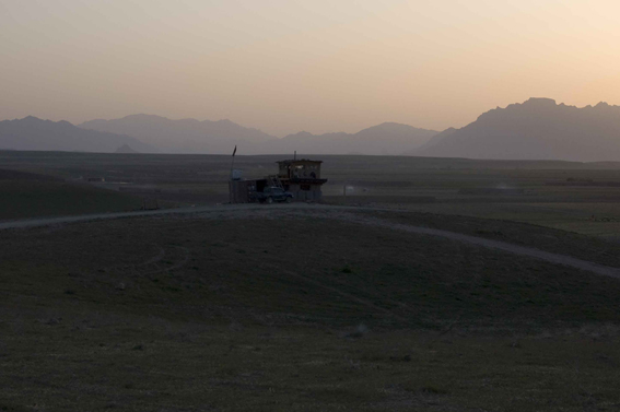 LYNDELL BROWN CHARLES GREEN     Approaching Darkness, Base Perimeter with Afghan National Army Observation Post in Distance, Tarin Kowt Base, Uruzgan Province, Afghanistan  2007-08 Digital colour photographs, inkjet prints on rag paper, unframed 111.5 x 151.5 cm