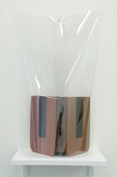 JACKY REDGATE    UBU  - Abridged Title   1 1995 - 2 2007   leather, paper, cellophane & wood 60 x 31 cm