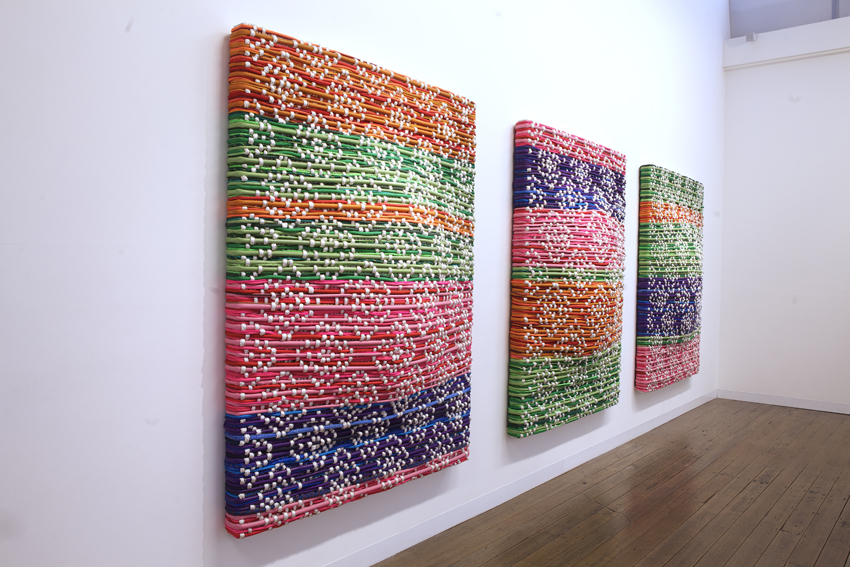 DANI MARTI     Shields 2, 3 and 4  2014 rope, stainless steel braided hose, plastic cord, automotive paint on aluminum frame   180 x 143 cm