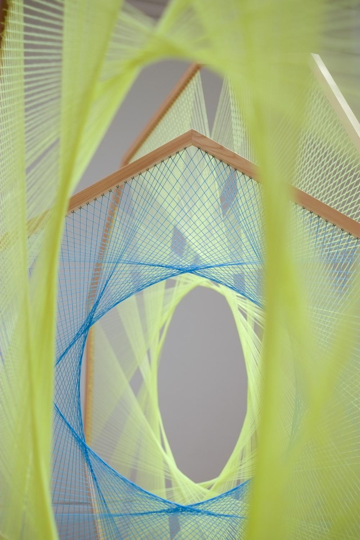 NIKE SAVVAS     Sliding Ladders: yellow with blue pentagon (detail)  2012 wool, wood, steel, image credit: Jonty Wilde 231.5 x 382 cm