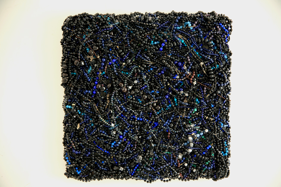 DANI MARTI     Monster (black)  2007 Second hand beaded necklaces and Spanish rosary beads collected between 2000 and 2003. Tubular mesh used for mussel farming on wood  66 x 66 cm