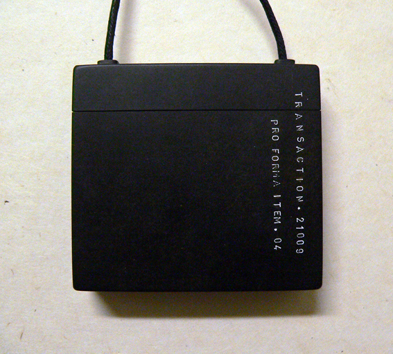 Black Box. (Containing Small Cotton Veil) , 2009, Black bakelite/cotton/linen thread, 65 x 60 mm