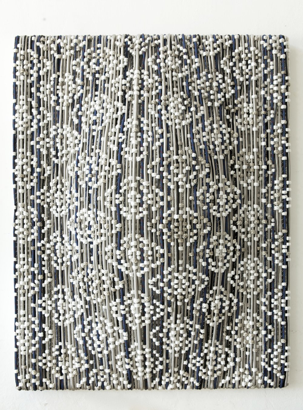 Dani Marti,  Shield – Study for a Portrait – Take 1 , 2015, stainless steel braided hose, polyester, nylon, rubber and leather on aluminium frame, 180 x 140 x 30cm.
