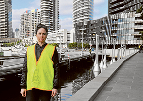 Image: the artist, Tracy Sarroff, with her installation Light Buoys, Docklands.
