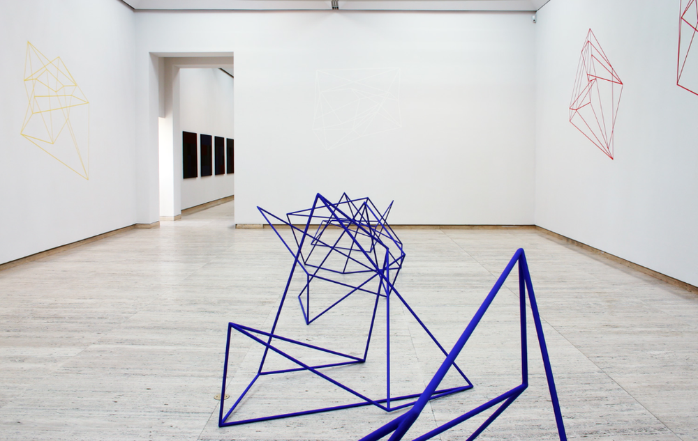 ROBERT OWEN   Vessel - Memory and logic units #1, 2, 7, 8  1997 Painted Steel 150 x 190 x 190 cm each  Hypercube wall drawings  1995 - 1997 Coloured tape on wall Dimensions variable