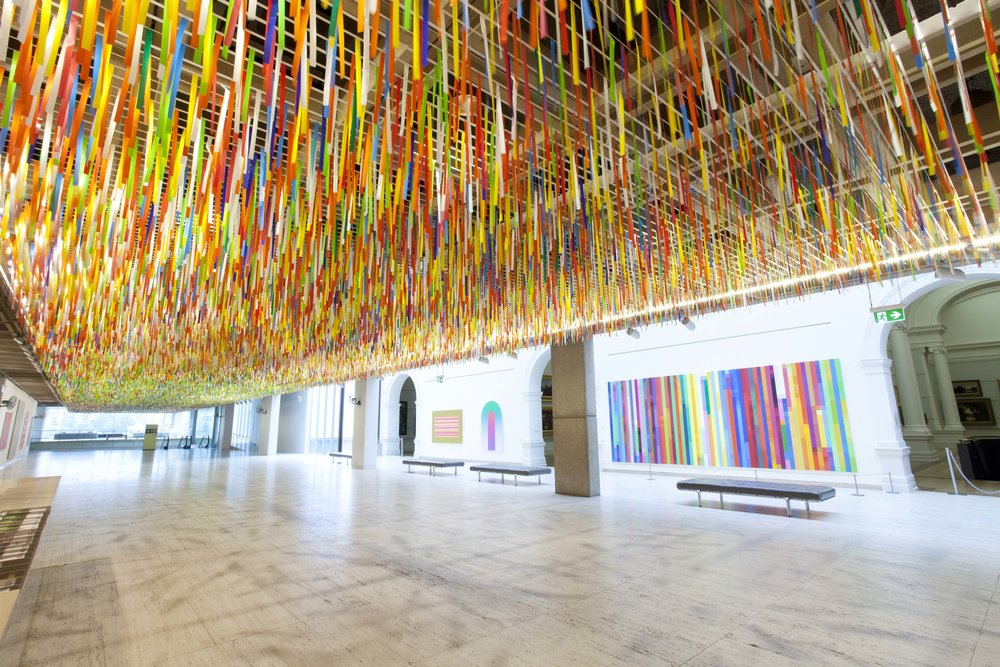 NIKE SAVVAS   Rally  (Installation view) 2014 Plastic bunting, wire rigging, electric fans Dimensions variable
