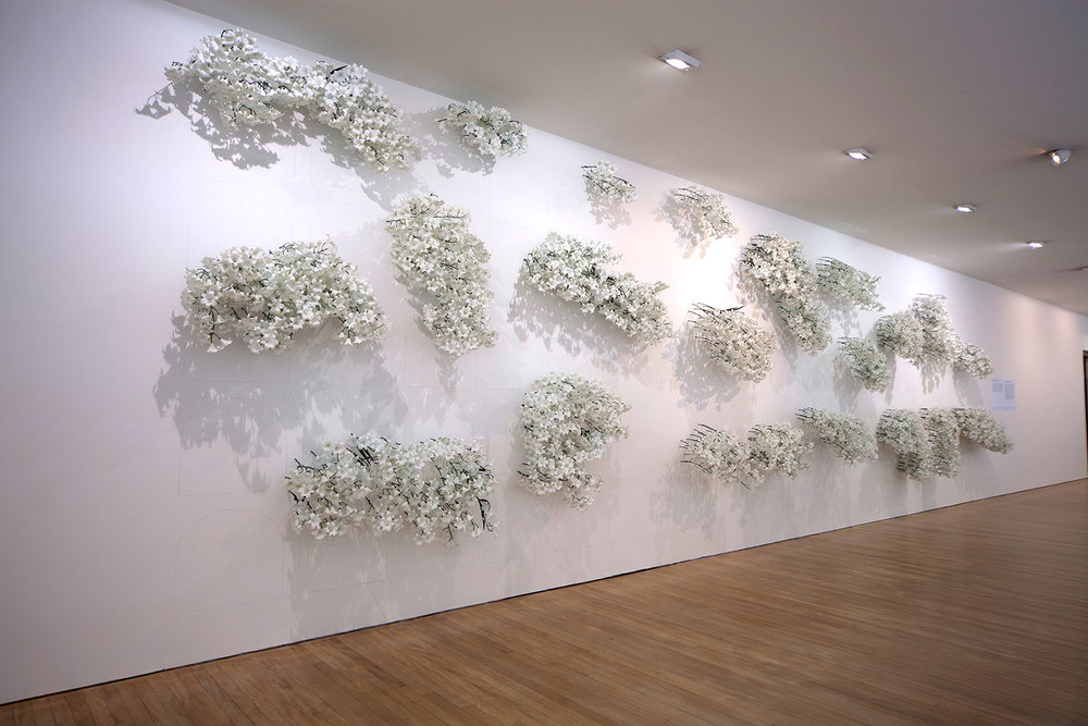 MARIA FERNANDA CARDOSO   Cemetery, vertical garden  (Install View) 1992 Plastic flowers, pencil on wall Dimensions variable