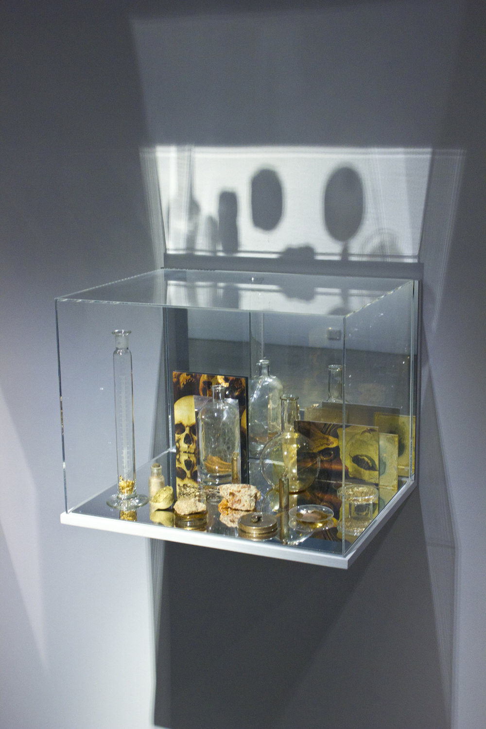 JANET LAURENCE   What Colour is the Sacred? (Gold)  2018 Plywood, acrylic, mirror, details of Aelbert Jansz van der Schoor 'Vanitas still life', c1660–65 printed on archival cotton rag with ultra chrome pigment inks, Oil glaze on acrylic, pigment, acrylic lens, scientific glass, gold leaf, ochre, copper, colophony, guided objects 45 x 60 x 45 cm