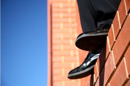 man-standing-on-ledge