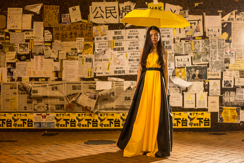 Without Fear: The Umbrella Movement, a dress that can transform to provide protection and shelter during times of civil unrest. Image credit, Wong Ka Wing. Model, Lee lee lee.