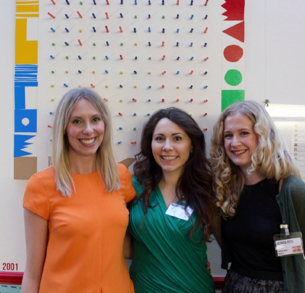 The Neuroscientists: Louise Croft, Michelle Downes, and Georgia Pitts in front of Julia Vogl's collaborative piece at the launch night of BEYOND SEIZURES