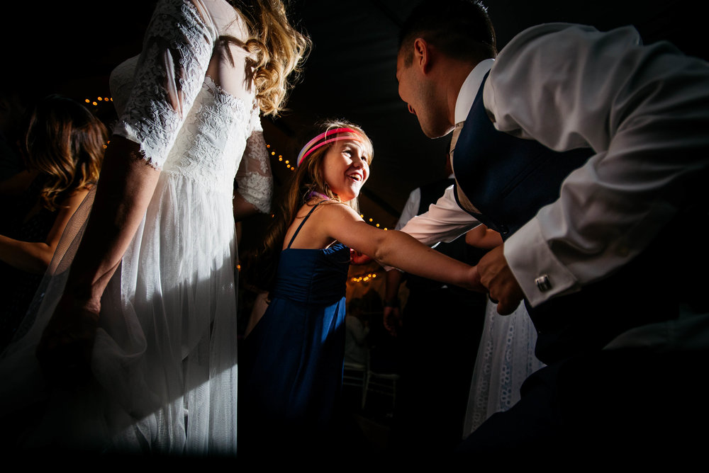 Extended Play Photography documentary wedding photography in Albuquerque, New Mexico. Capitan wedding reception dancing candid.