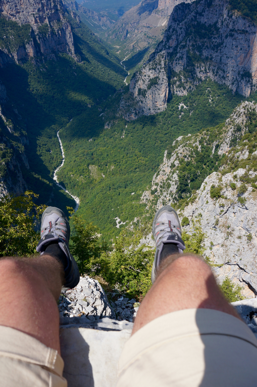 vikos gorge view with legs