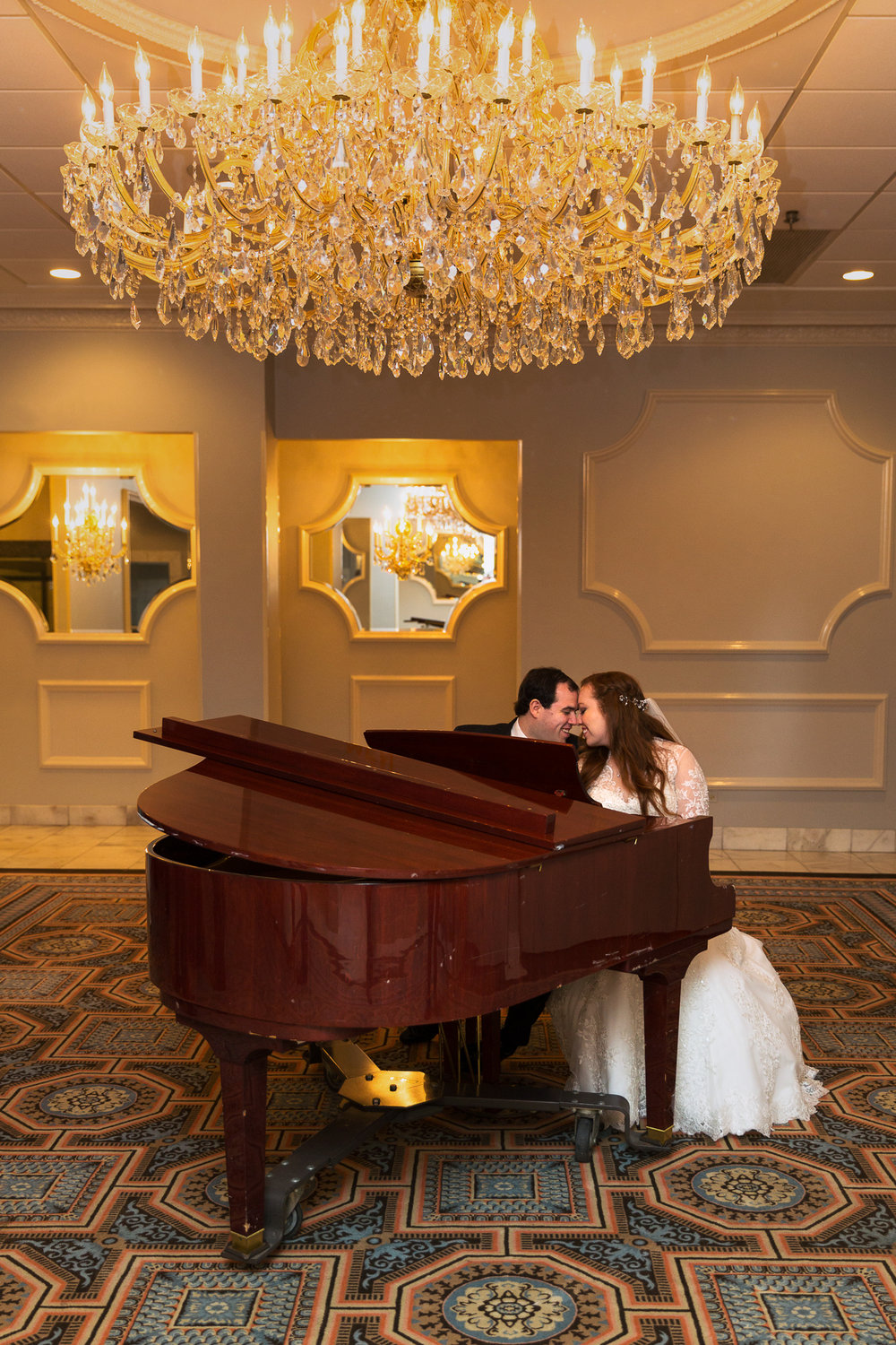 Bride and groom together at a piano