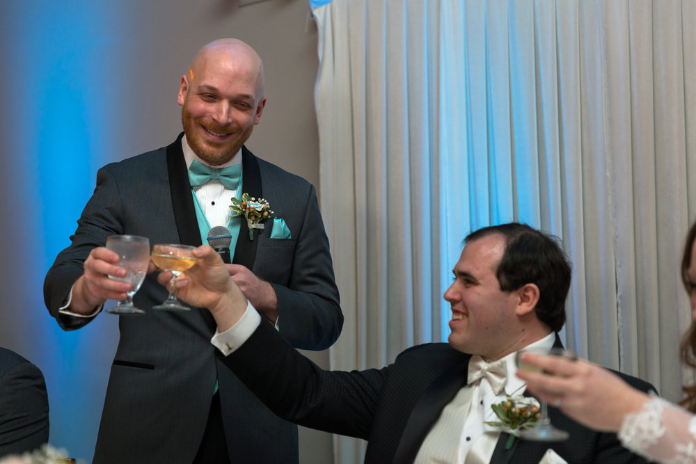 Groom and best man toasting