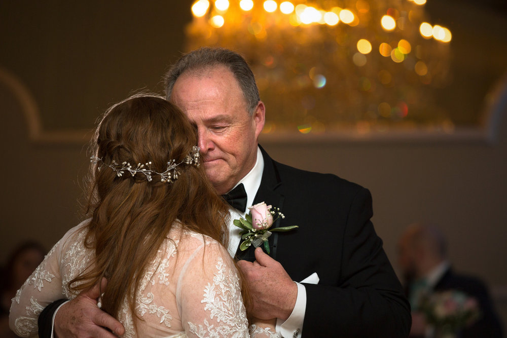 Father and bride dancing together