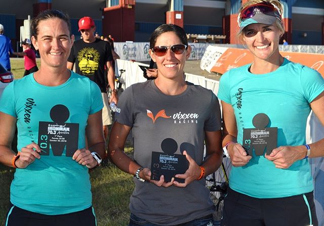 "This picture is an oldie but a goodie. This is from Austin 70.3 in 2016.  There is so much more than meets the eye. All of these women races great as is shown by the hardware they are holding. This represents 3 of the top 10 amateurs at this race, 3 athletes to win the Ironman tri club division and 3 qualifying races for the IM 70.3 World Championships. What isn't shown is ALL 3 OF THESE WOMEN WERE RACING ON THEIR PERIOD. None of them felt great, the day was not ideal and 1 was completely surprised that morning, but they got it done. Women's racing has its own unique challenges but nothing more than we all can handle. The more we talk about the P word, aunt flow, code red....the more we grow and the less taboo it becomes.  We have an idea, we're going to call it #racecodered We are going to see if we can get every Vixxen athlete to throw a tampon in her morning race bag whether she needs it or not. We want you all to do the same. If your race morning surprises you, how great would it be if you could just turn to the woman next to you and say ""CODE RED"" versus running around looking for someone to help that may have a tampon? Who's in??? Guys, you could help to! Who else thinks this could build some momentum? @ubykotex ??????"