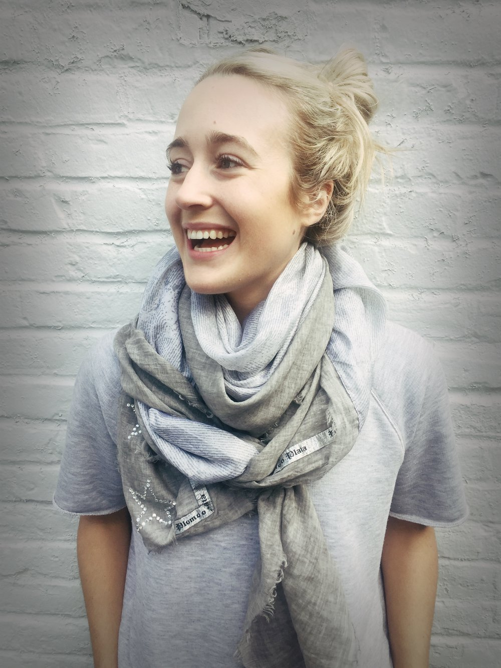 All smiles Kayla!! Showing off our Plomo o Plata scarf and ZK sweatshirt