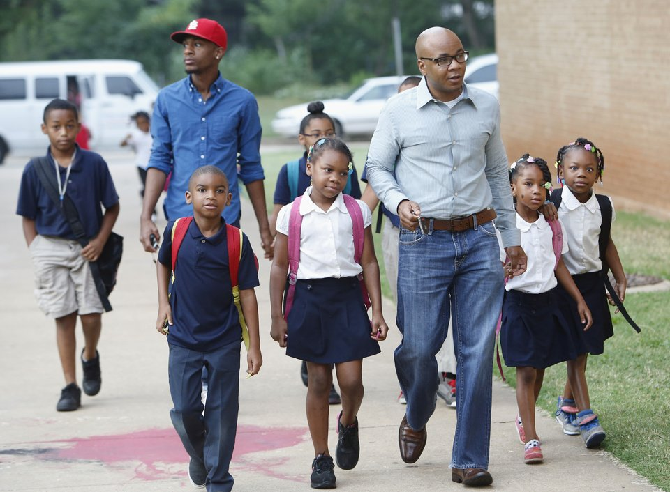 Above: Students and their dads arrive Friday at Take Your Child to School Day at F.D. Moon Elementary School. Photos by David McDaniel, The Oklahoman