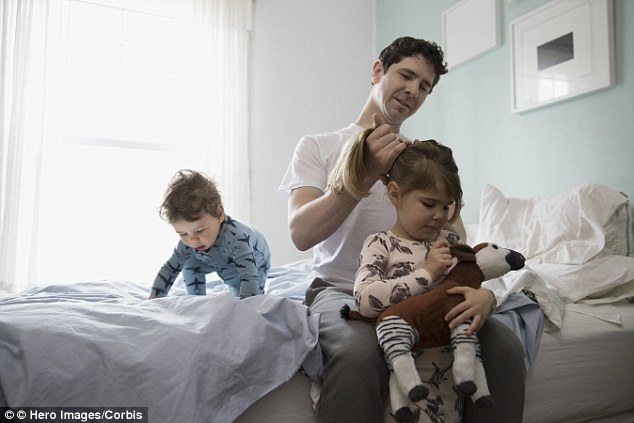 More than six out of ten dads believe they enjoy a better, more supportive and hands-on relationship with their own children than they themselves experienced (file photo) while growing up