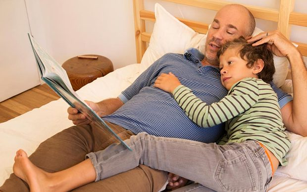 Reading relaxes father as well as son. (Image: Alamy Stock Photo)