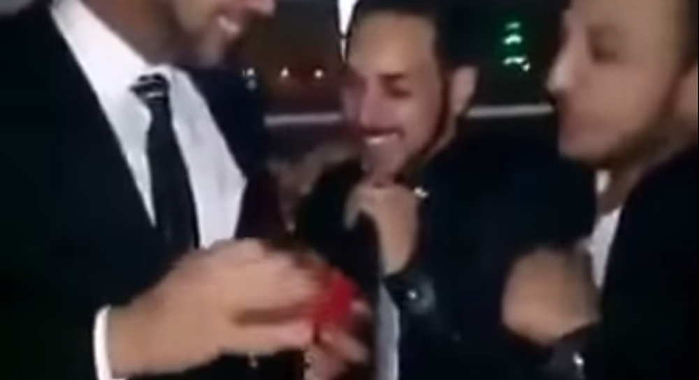 Screengrab of two men exchanging rings in what is likely Egypt's first gay wedding. (YouTube)