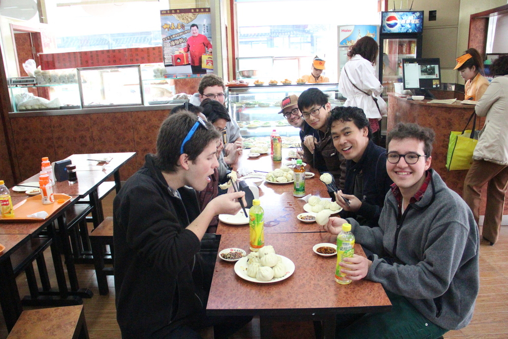 The Yale Alley Cats have a traditional Chinese breakfast in Beijing