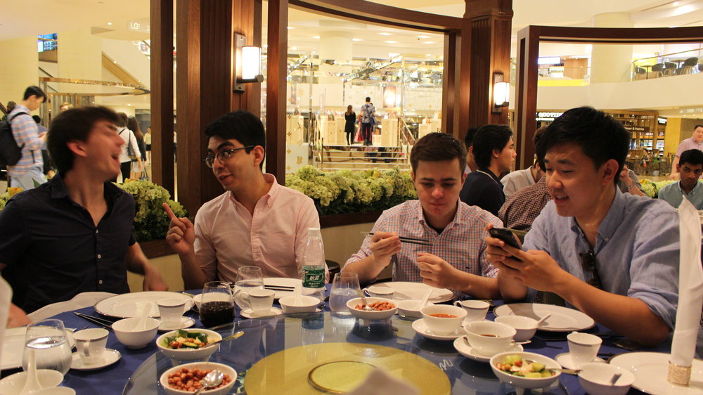 Group lunch eating Roast Duck