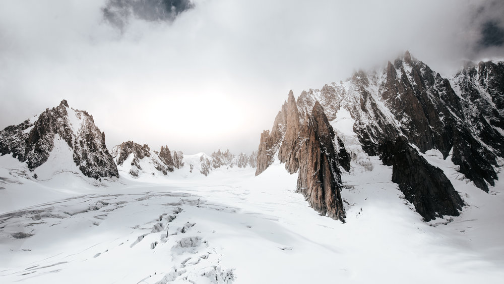Mont Blanc. 35mm. The enormous cracks in the glacier fade into the distance. The mighty towers of the massif shrink away relative to the imposing giant on the righthand side. Textures in this image take the place of a person to scale things.