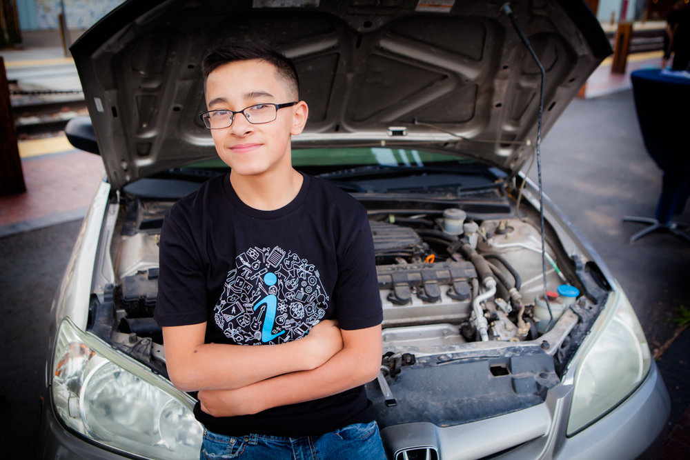 Martin Gonzales -  Martin Gonzales was born in Albuquerque and has lived in Santa Fe for four years. He is thirteen years of age and is in 8th grade at Mandela  International Magnet School and plans to attend MIT University when he graduates. He has a mentorship in auto mechanics and says that it allows lots of young adults to practice something before going off to college.