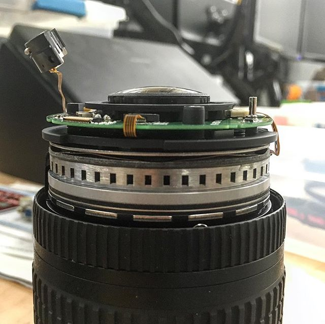 So that metal ring is apparently the silent wave motor. I'm pretty sure it's some variant of a brushless pancake motor. Tried wiggling it a bit to see if it would loosen anything up. #nikon #repair #nikkor1024