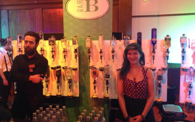 Gin Festival servers with bottles of gin on the wall and Fever Tree tonics for topping up