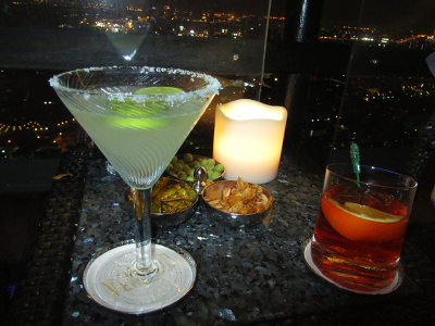 Negroni to the right, Margarita to the left, Bangkok lights all around
