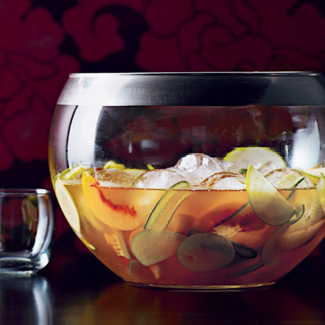 1 whole bottle of craft gin, 1 whole bottle of vermouth, 8 ounces of elderflower liqueur and 8 ounces of peach liqueur - good thing this pitcher cocktail is topped off with sparkling water. You'll need it in the summer sun!