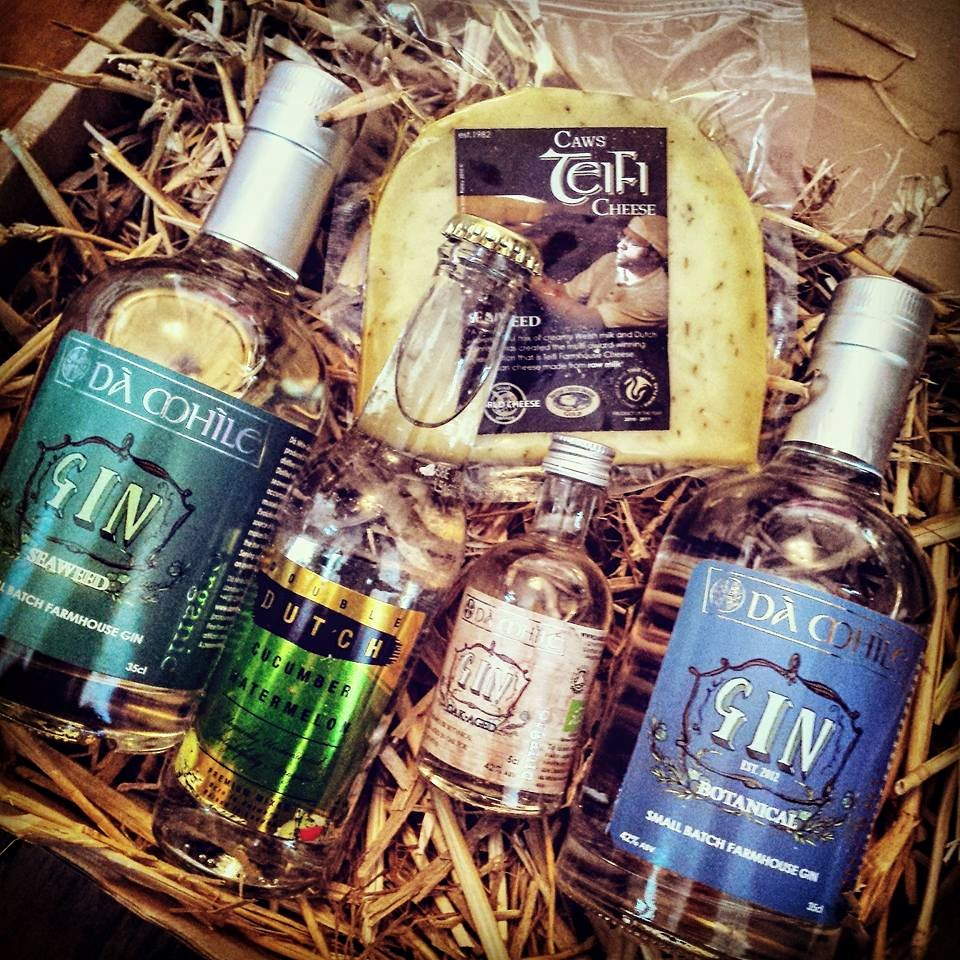 Our July Gin of the Month parcel with three different gins from the Da Mhile Distillery, their award-winning seaweed cheese and a new mixer from Double Dutch Drinks. Thanks to club members Liana Phillips for the gintastic image!