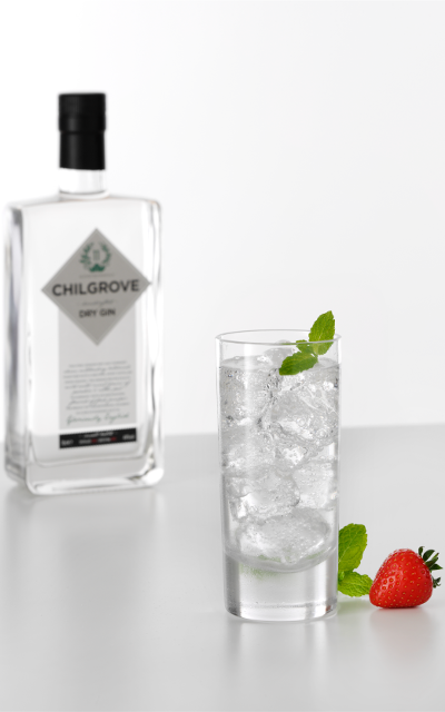2 measures of Chilgrove Dry Gin Top up with Fentiman's Tonic Water Garnish with sprig of mint