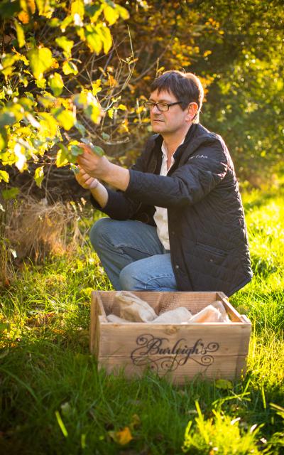 Jamie Baxter picking botanicals in Burleigh's Wood