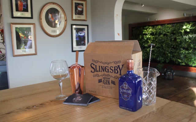 Slingsby Gin backed by a botanical wall in the Spirit of Harrogate shop
