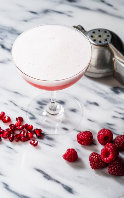 The clover club pink raspberry gin cocktail drink